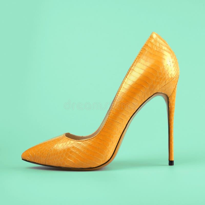 Yellow high heel shoes stock photo