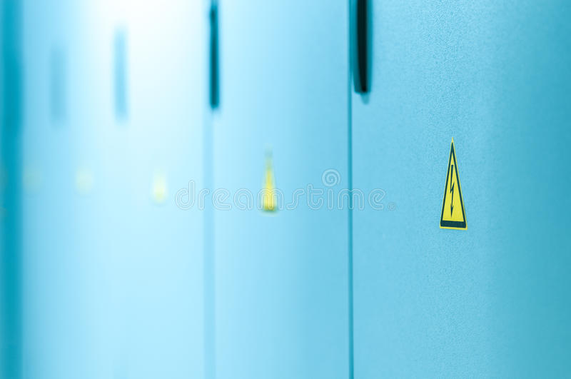 Download Yellow High Voltage Sign On Blue Doors. Stock Image - Image: 28690743