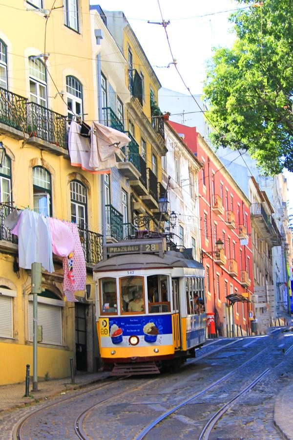 Yellow historic tram in lisbon driving through the old town of alfama stock photos