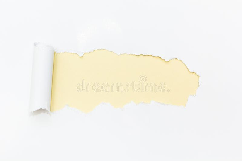 Yellow hole in white paper. Empty space for text royalty free stock photography