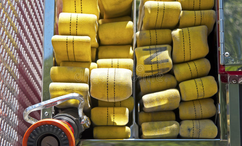 Yellow hose on a firetruck royalty free stock photos