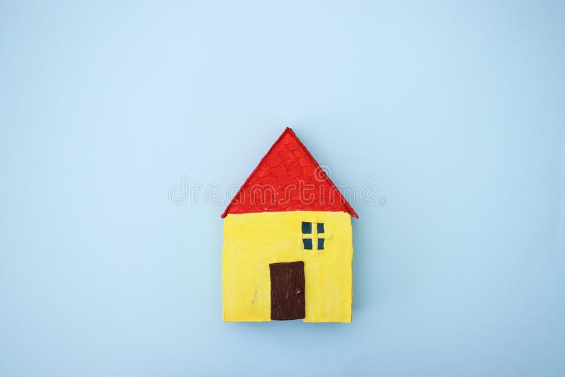 Yellow house on blue background - Hand made.  royalty free stock photos