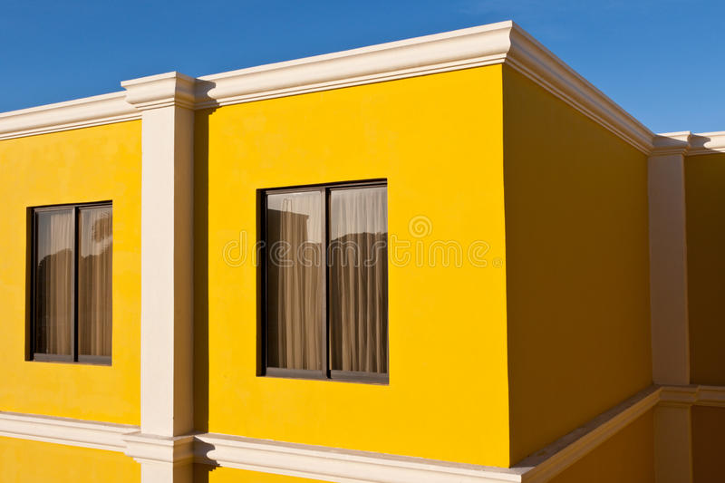 Yellow house and blue sky royalty free stock photo