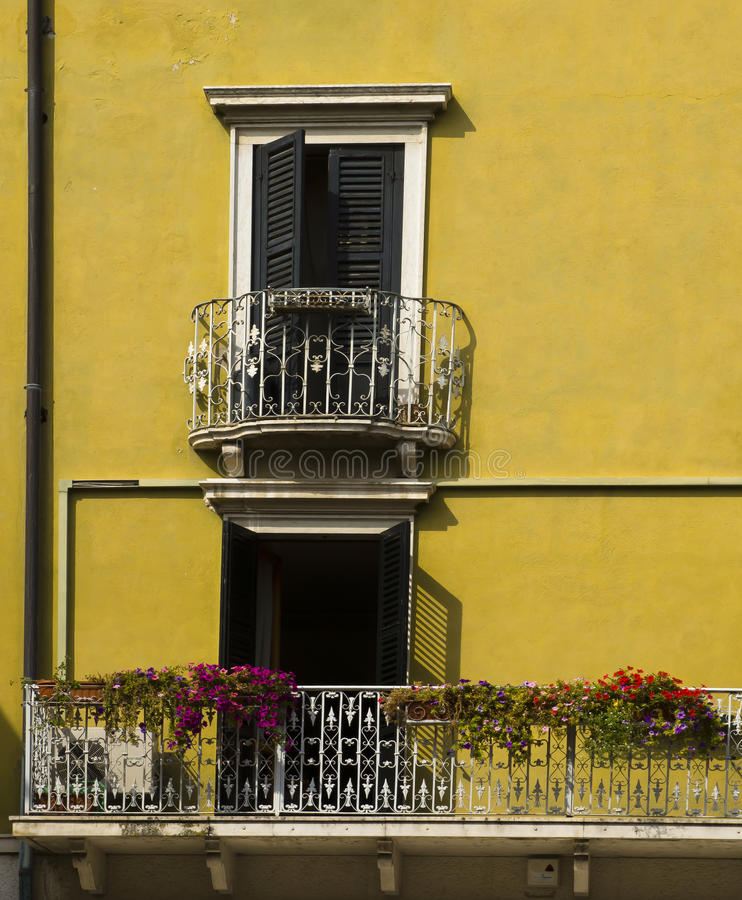 Yellow house decorated balconies royalty free stock photos