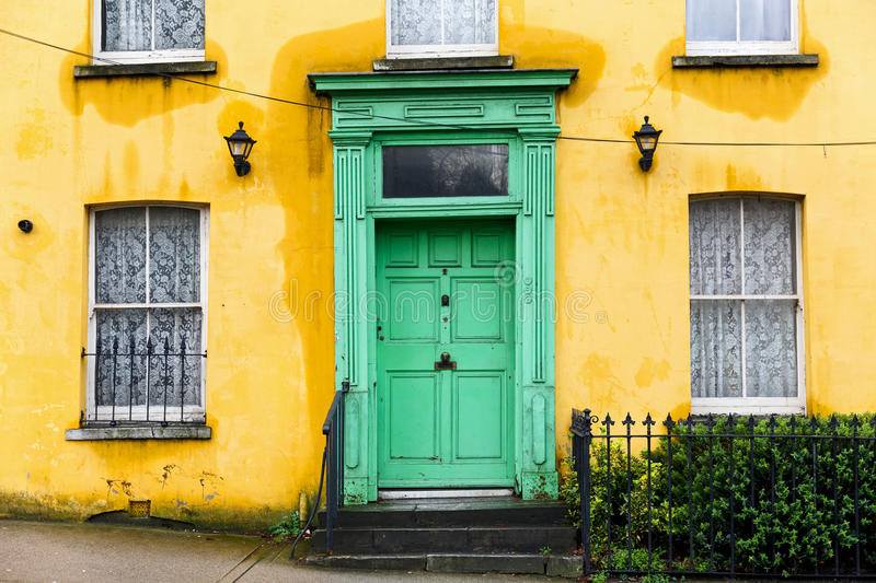 Yellow House With Green Front Door Stock Image - Image of color ...