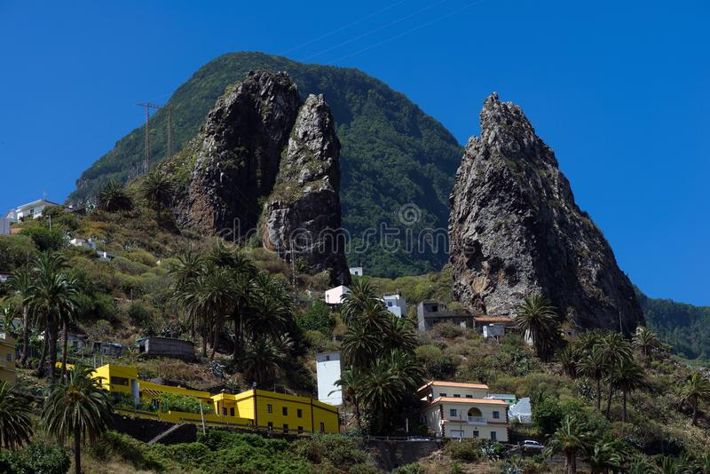 Yellow house in the mountains at La Gomera. La Gomera is a Spanish island located in the Atlantic Ocean as part of the Canary Islands. The island is the second stock photography