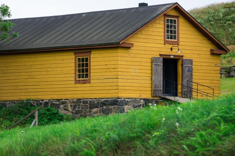 Yellow house in Suomenlinna Sveaborg Fortress. Helsinki, Finland. August 26, 2017. Yellow house in Suomenlinna Sveaborg Fortress royalty free stock photos