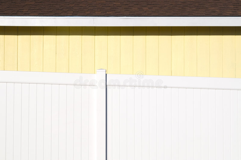Yellow House with White Fence. Side of a Yellow House with White Fence stock image