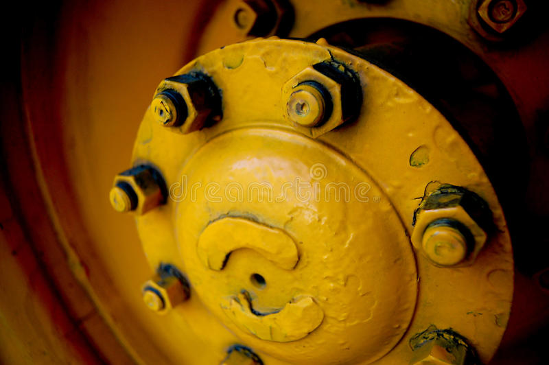 Yellow Hubcap. A yellow hubcap from a school bus royalty free stock images
