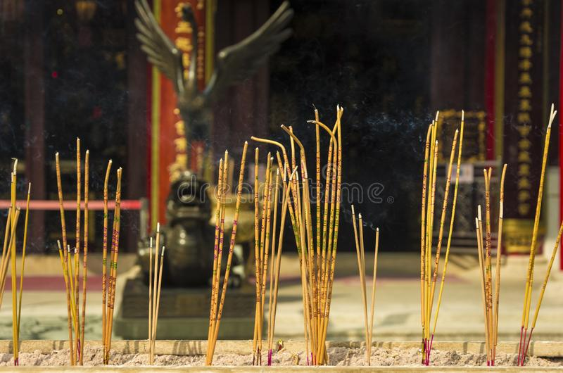 Incense sticks burning at a Taoist temple of Wong Tai Sin, Hong Kong. Yellow incense sticks burning at a Taoist temple of Wong Tai Sin, Hong Kong royalty free stock image