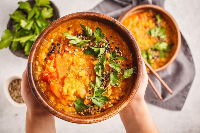 Yellow Indian vegan lentil soup curry with parsley and sesame in royalty free stock photography