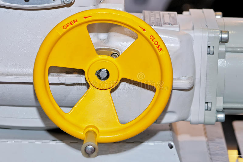 Yellow industrial valve with inscriptions Open Close royalty free stock images