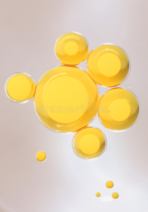 Yellow ink bubbles on oil