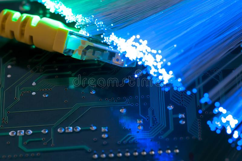 Yellow internet switch close up macro shot on computer circuit board royalty free stock image
