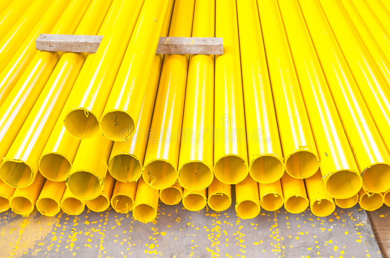 Yellow iron pipe. For construction stock photo