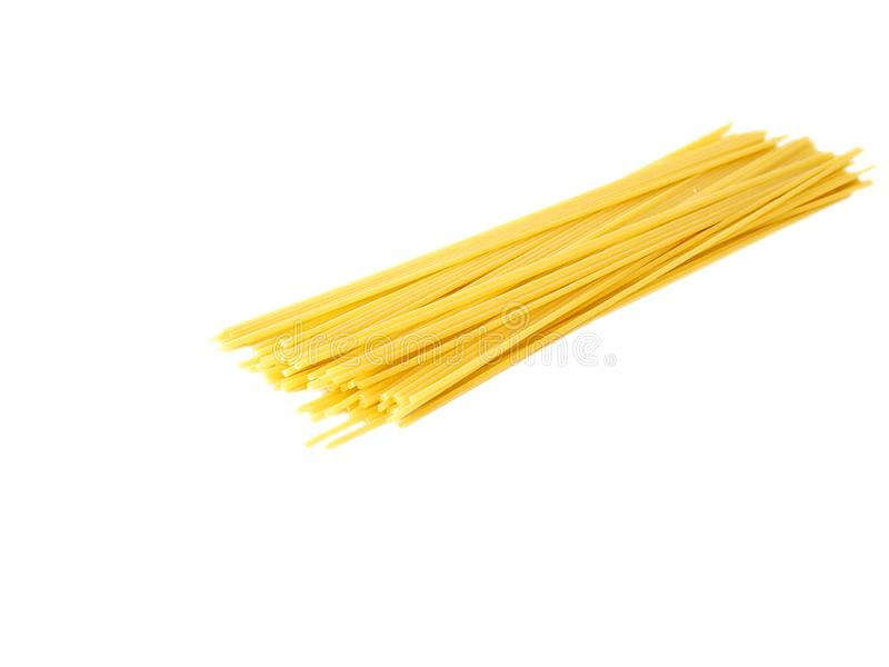 Yellow Italian spaghetti on a white background ready to be cooked. stock photos