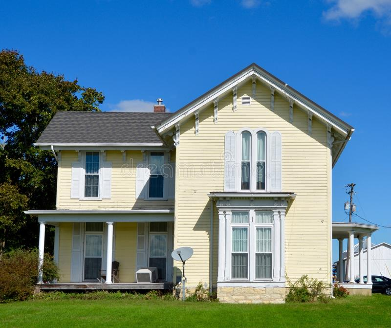 A Yellow Italianate. This is a Fall picture of a yellow house located in Sheffield, Illinois. This house built in 1897 is an example of Italianate architecture royalty free stock image