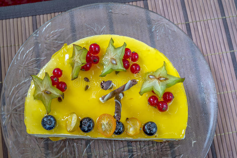 Yellow jelly cheesecake with berries royalty free stock photos