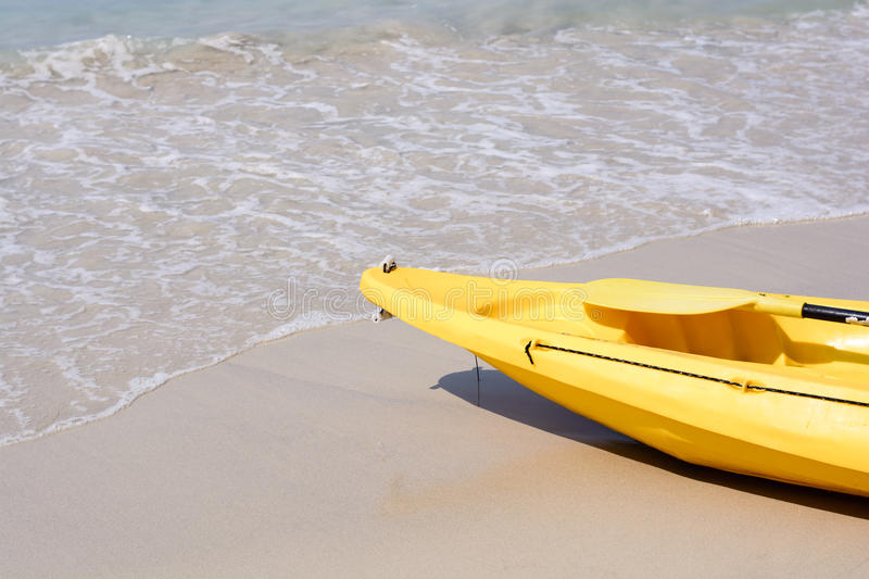 Yellow kayak on the beach royalty free stock photography