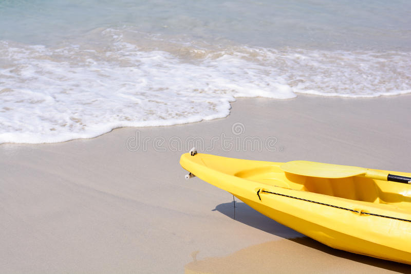 Yellow kayak on the beach stock images