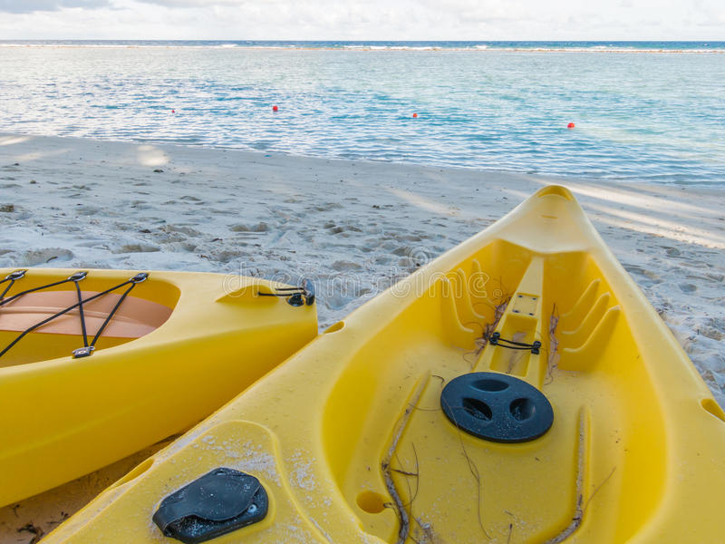 Yellow kayak on the tropical sandy beach royalty free stock photos
