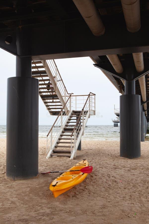 Yellow kayak under the Heringsdorf Pier stock images