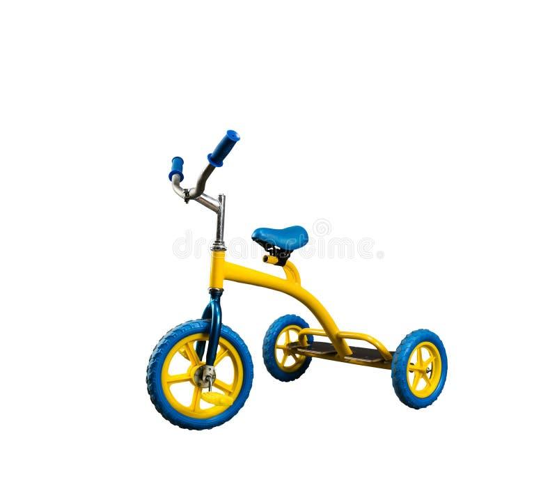 Yellow kid's bicycle isolated stock photography