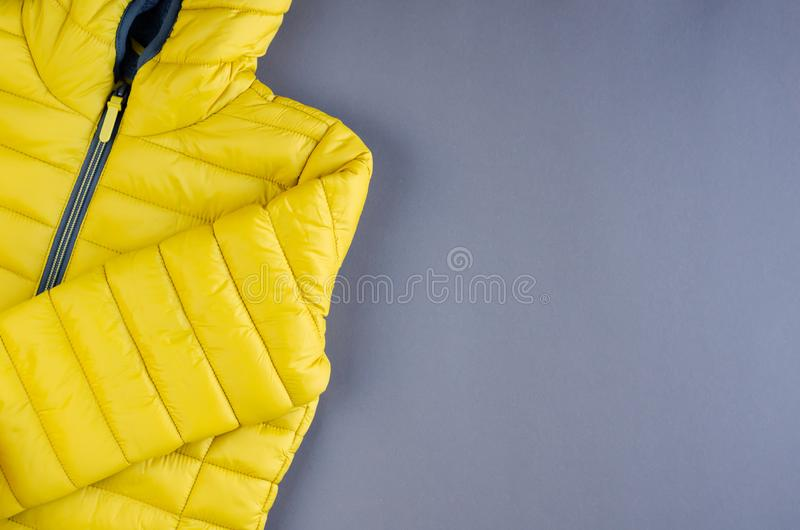 Yellow kids winter jacket composition on yellow background. Flat lay, layout and tabletop mockup with copy space, above, flatlay, view, desk, frame, overhead stock photos