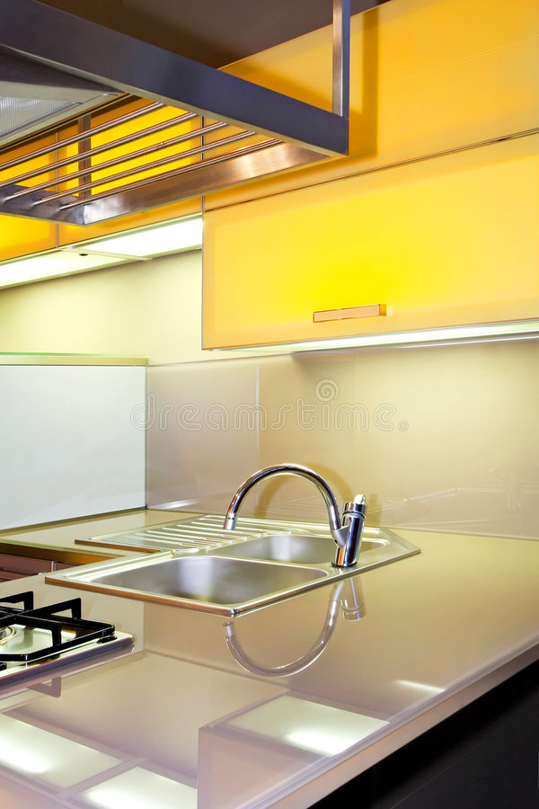 Yellow kitchen sink stock images