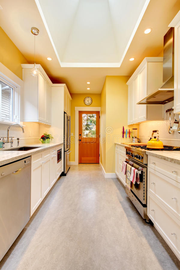 Yellow Kitchen With White Cabinets And Stove Stock Image Of Estate Elegant 23908763