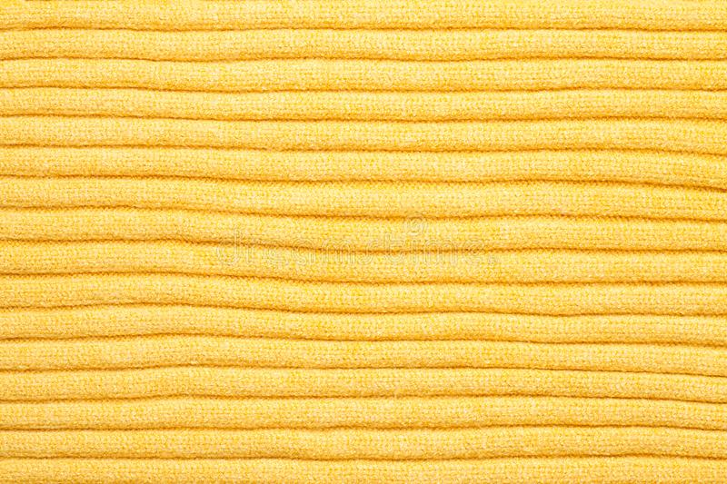 yellow knitted fabric background stock images