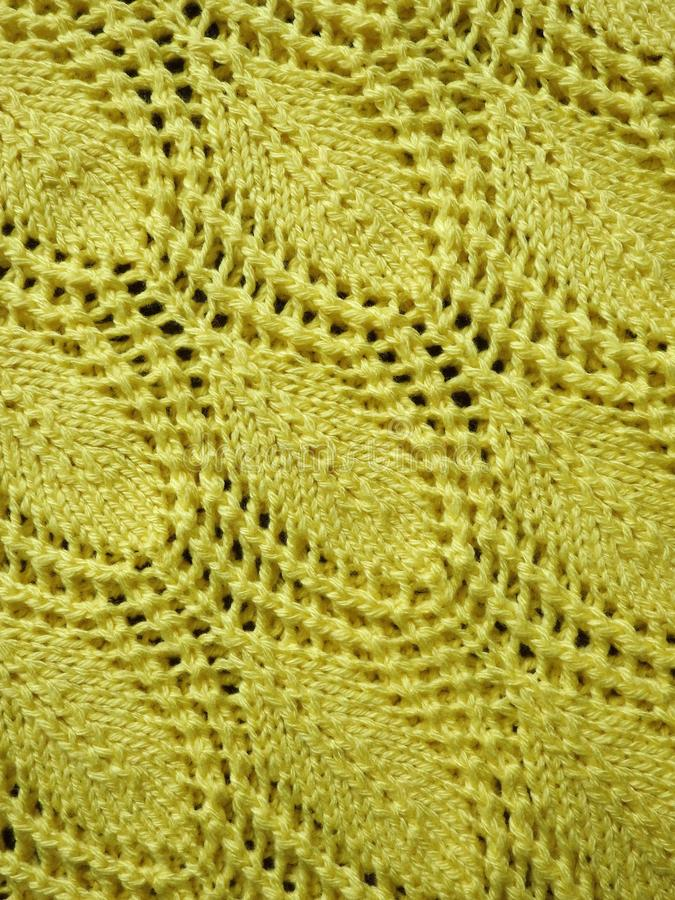 Yellow knitted surface texture stock image