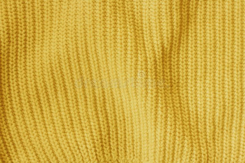 Yellow knitted woolen fabric pattern background royalty free stock photography