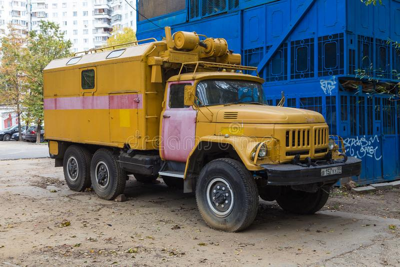Yellow large truck parked at Lazarevskij Pereulok street, Moscow, Russia. royalty free stock photography
