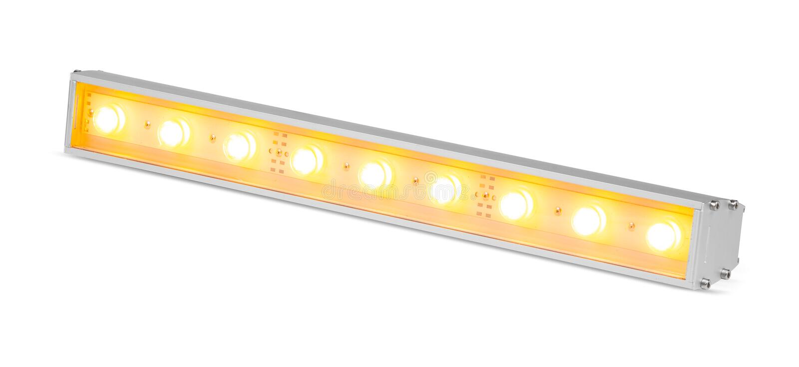 Yellow LED flood light outdoor projector lamp isolated on white background royalty free stock photography