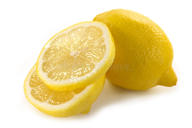 Yellow lemon. And lemon slices isolated royalty free stock images