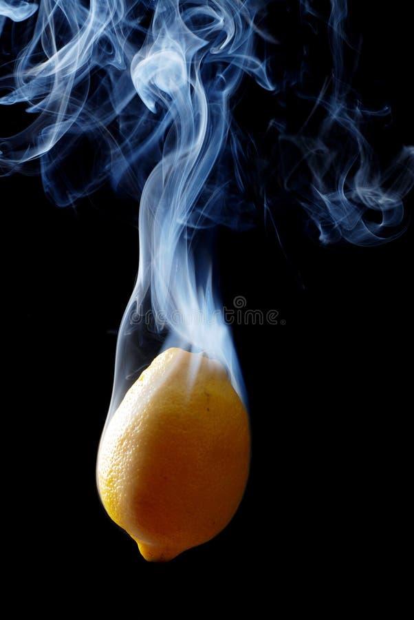 Yellow lemon and smoke royalty free stock photo