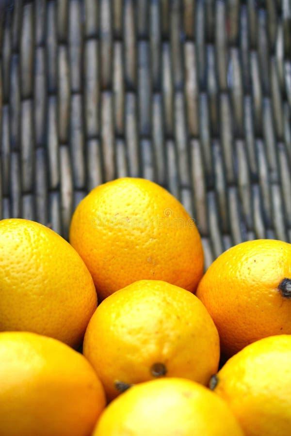 Yellow lemons in basket stock photo