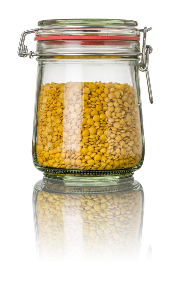 Yellow lentils in a jar stock photo
