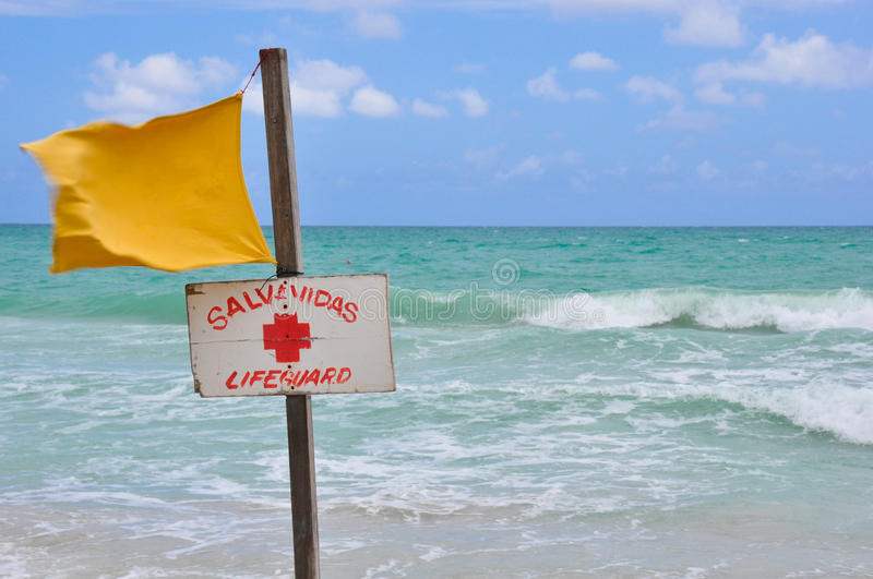 Yellow life saving flag at the beach