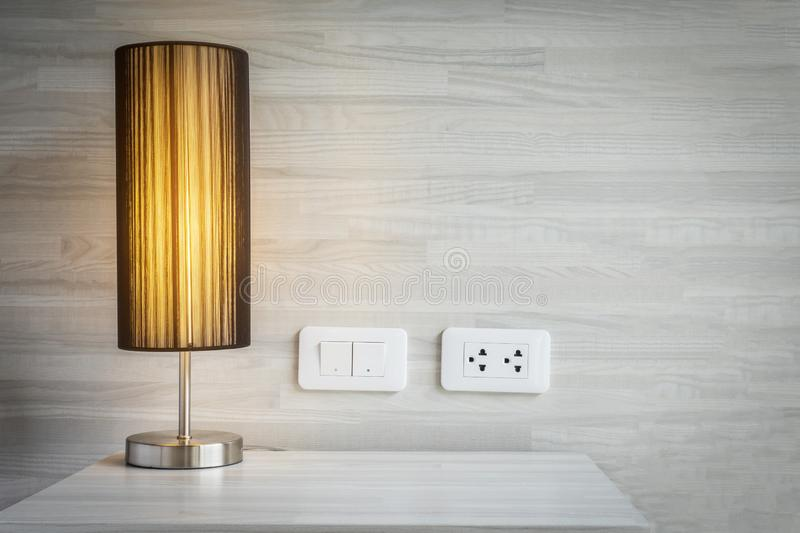 Yellow light decoration in bed room with switch and electric plug connector stock photos