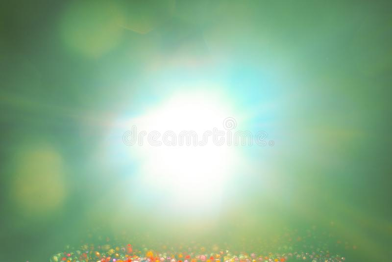 Yellow light flare special effect and beads on black background , concert lighting.  stock photos