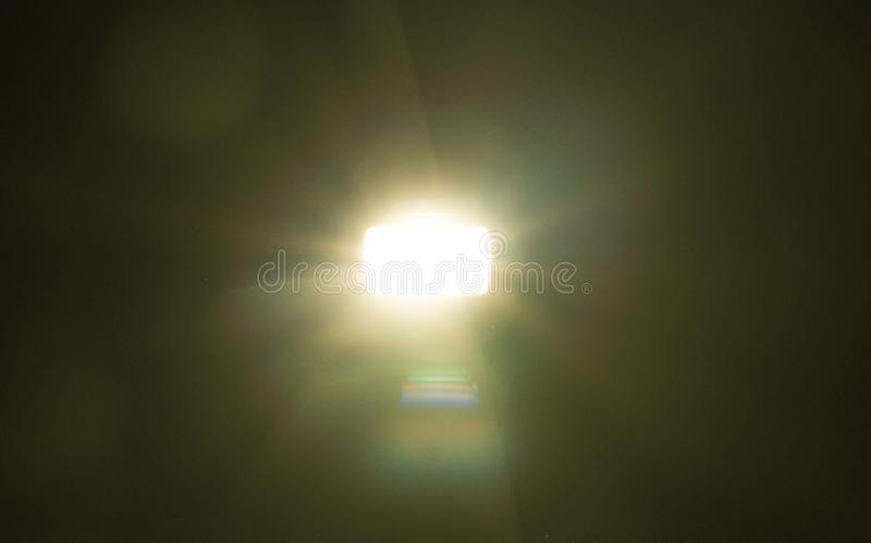 Yellow light flare special effect  on black background , concert lighting.  royalty free stock images