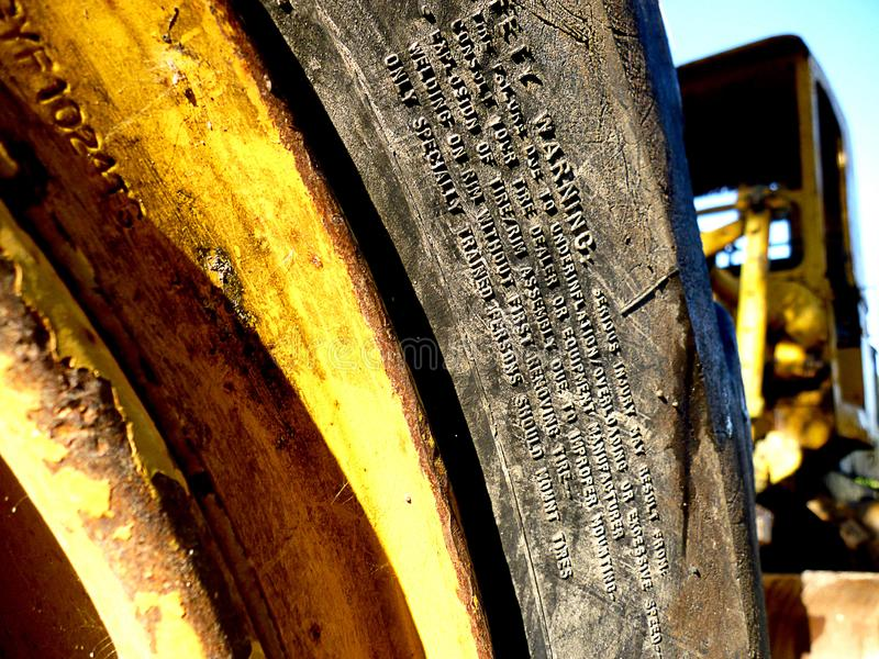 Yellow light of a truck. Yellow light from a truck to detail of a tire stock photo