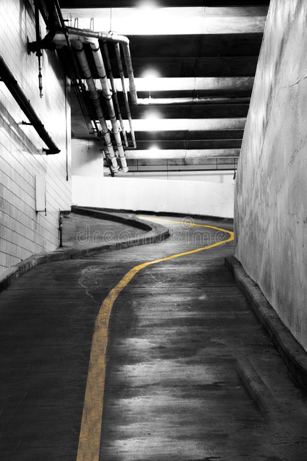 Yellow line in a parking garage. A picture of a yellow line in a parking garage in the summer royalty free stock photo