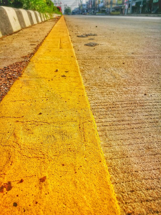 The yellow line on the road. stock images