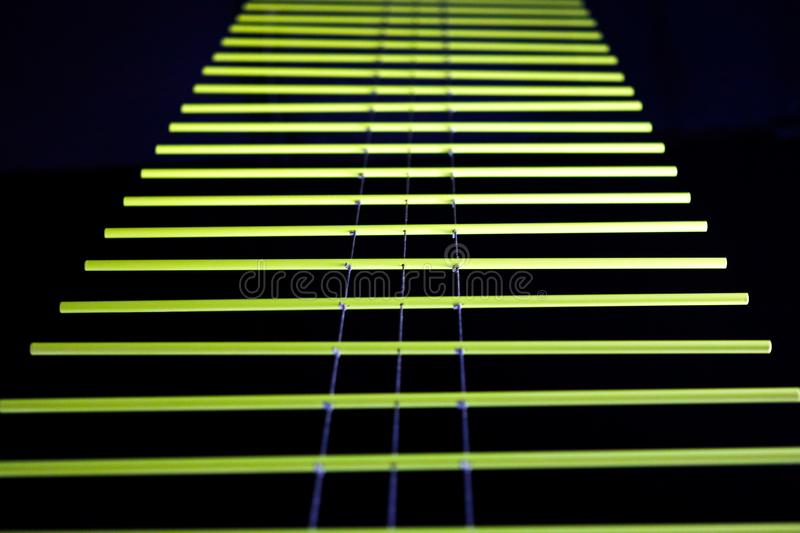 Yellow lines on a black background royalty free stock image