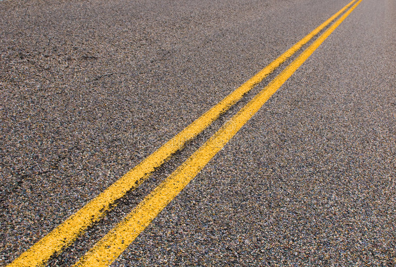 Yellow lines on the highway stock image