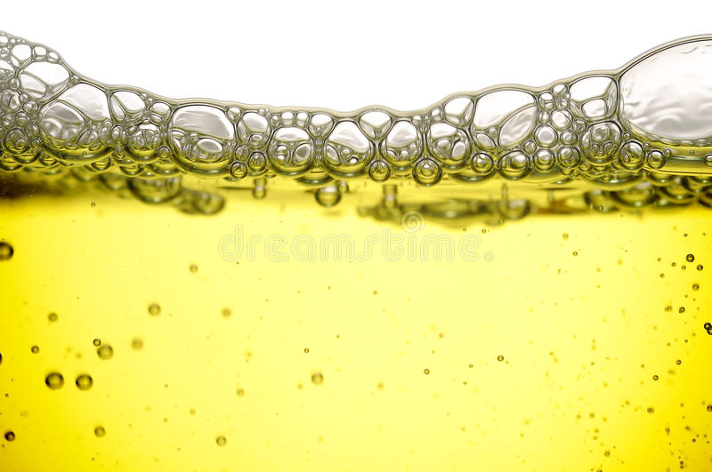 Yellow Liquid With Bubbles stock images