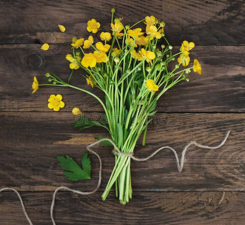 Yellow Little Flowers Bouquet gift Spring time Rustic Wooden Background Flat Lay Square Image. Yellow Little Flowers Bouquet gift Spring time Rustic Wooden royalty free stock photography